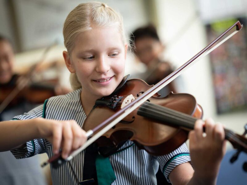 Primary student playing the violin